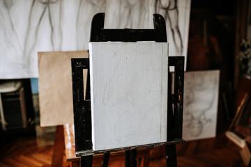 Blank canvas. Artistic equipment in a artist studio.