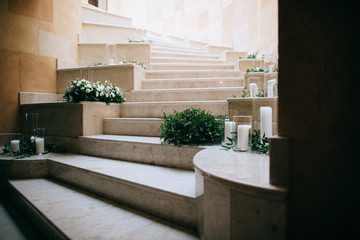 Wedding floral decoration on the stairs with white candles