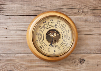 aneroid barometer on a wooden wall