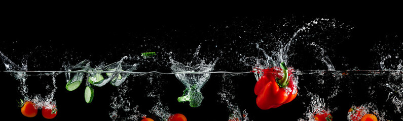 group of vegetables in water splash