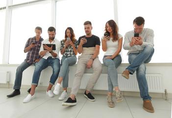 business team using modern gadgets