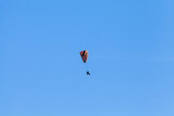 Paraglider in blue sky, ultralight aircraft