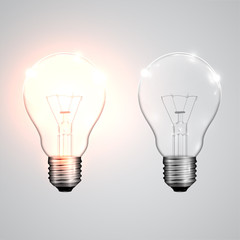 Realistic lightbulbs hanging and working, vector.
