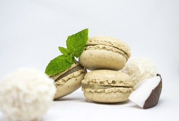 Vanilla coco macaroons desert with fresh coconut and mint leaves on white background