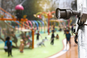 CCTV monitoring against blur kids enjoying their time at kid Water Park