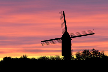 Windmill silhouette in sunset