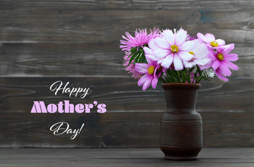 Happy Mothers Day card with flowers in the vase