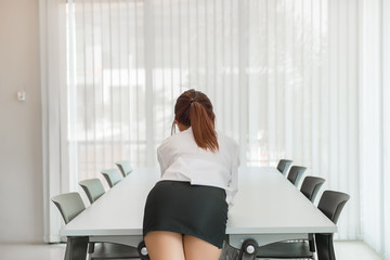 Portrait of asian sexy woman in the office from back angle,thailand people