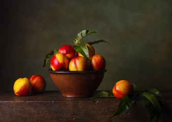 Still life with nectarines in the bowl