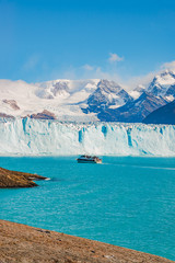 View of glacier Perito Moreno in Patagonia and touristic boat