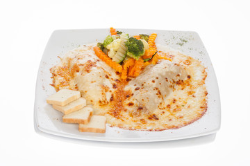 gratin cannelloni accompanied with cooked vegetables