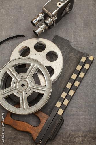Old movie camera film reels and clapperboards stock photo and old movie camera film reels and clapperboards altavistaventures Choice Image