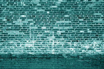 Weathered brick wall background in cyan tone.