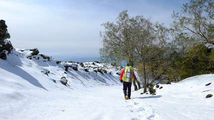 Hiker Walking On Snow In Etna Park, Sicily