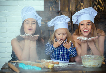 Child and women blowing flour