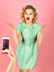 Retro happy woman pose for cell phone photo, vintage look.