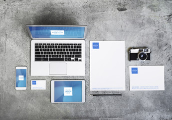 Devices, Laptop, and Stationery on Concrete Background Mockup 1