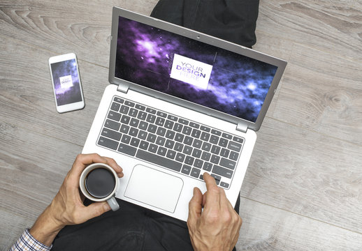 Laptop and Smartphone User Sitting on Floor with Coffee Mockup 1