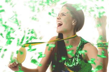 Brazilian young woman fan celebrating