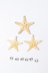 search photos sand and coral Nusa Penida Bali Gardens three starfish on a white background logo