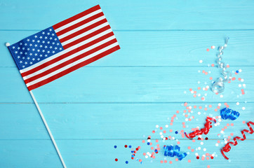 American flag and confetti on wooden background. USA holiday
