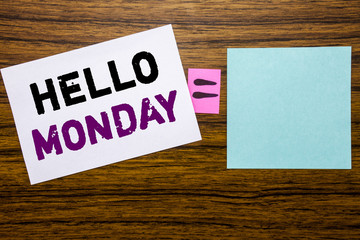 Handwriting Announcement text showing Hello Monday. Business concept for Day Week Start written on sticky note paper on wooden background. Equation mathematical sign for your space