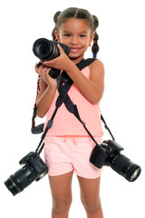 Cute multiracial small girl carrying three professional cameras