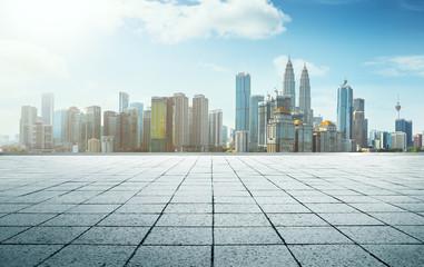 Perspective  empty marble floor in front of  city skyline background .