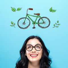 Eco Bicycle with happy young woman on a blue background