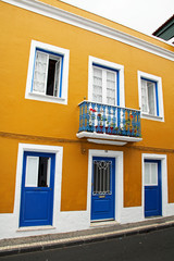 Bright House Architecture Mustard Color with Blue Doors in the Azores