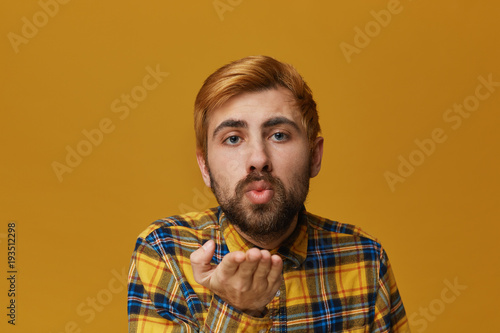 Handsome Guy Flirting With Girl With Blowing Kiss Wearing Checkered