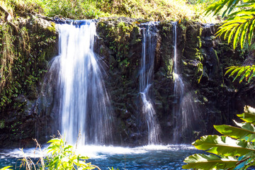 Triple waterfall and blue pool found along the legendary road to Hana on the island of Maui, Hawaii
