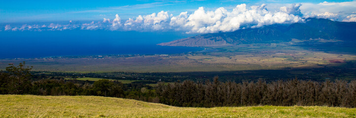 Ma'alaea Bay and Puu Kukui, the cloud-shrouded volcano on the north end of the island of Maui in Hawaii, photographed from Haleakala, the other volcano on the island