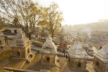 Stupas and cremation smoke at Pashupatinath Hindu temple in Nepal