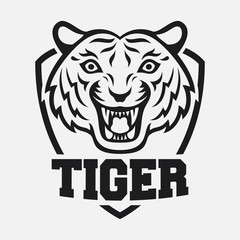 Mascot of black tiger's head on shield background