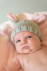 closeup of a newborn baby in a knit bunny ear hat