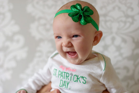 Irish baby with blue eyes wearing St Patrick's Day outfit