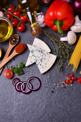 Blue cheese with spices and vegetables