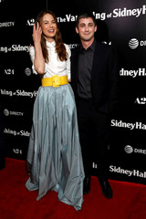 """Cast members Monaghan and Lerman pose at a premiere for """"The Vanishing of Sidney Hall"""" in Los Angeles"""