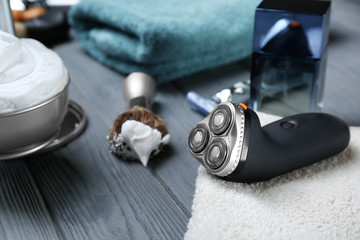 Electric shaver for man on wooden table