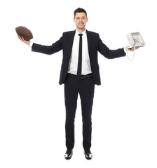 Businessman with rugby ball and telephone on white background