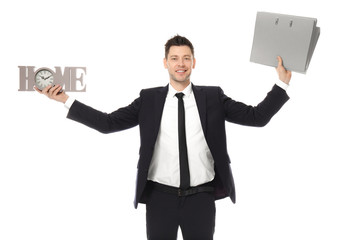 Businessman with word HOME and folders on white background