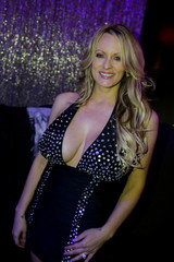 Adult-film actress Clifford, also known as Stormy Daniels, poses for pictures at the end of her striptease show at Gossip Gentleman club in Long Island, New York