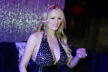 Adult-film actress Clifford, also known as Stormy Daniels, poses for pictures at the end of her striptease show in Gossip Gentleman club in Long Island, New York