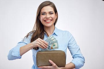 Portrait of happy woman holding cash money with purse.