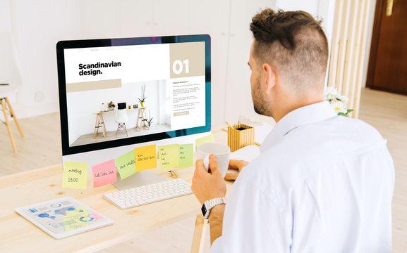 hipster man browsing scandinavian design website