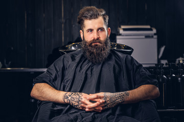 Handsome bearded man in the barbershop.