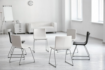 Chairs in room prepared for group psychotherapy session
