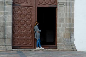 Woman in the door of the parish church of Nuestra Señora de la Asunción. San Sebastián de La Gomera. La Gomera. Canary Islands. Spain.