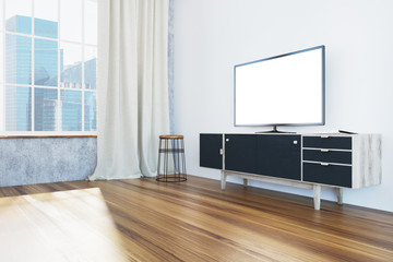 TV set on a black cabinet living room, side view